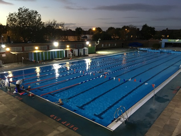 Charlton Lido's heated 50m pool at night