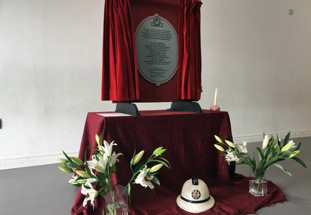 The unveiled plaque in the assembly hall
