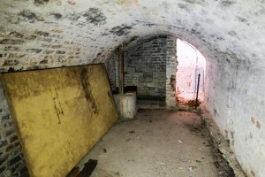 The undercroft space - formerly an air raid shelter - below Charlton's Summer House