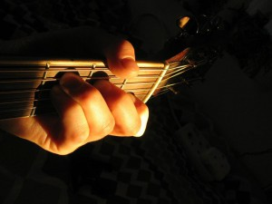 Guitar hand Charly Juma