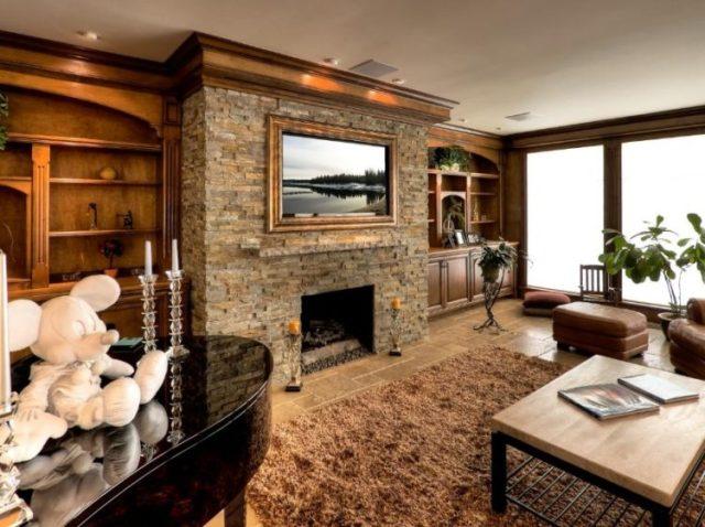 あなたのリビングルームで魅力的な積み上げ石の暖炉のデザインの暖かさを取得1