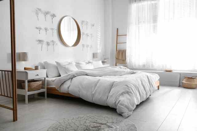 装飾的なミラー時計ライト寝室の壁の装飾のアイデア