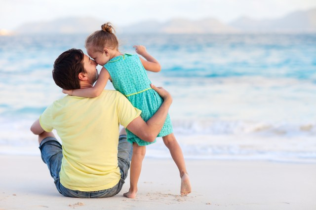 Powerful Words - Happy father and his sweet little daughter at beach