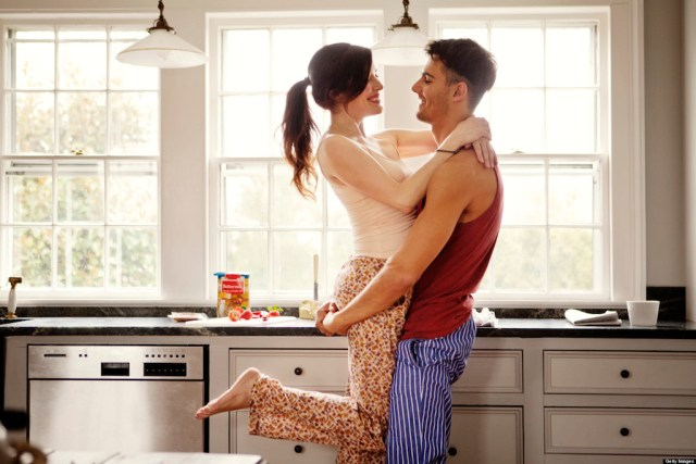 sexy words - Couple flirting while making breakfast