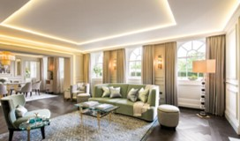 grand living room with lit ceiling, furniture and curtains