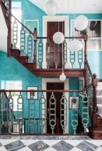 open staircase with art deco bannister and hanging lights
