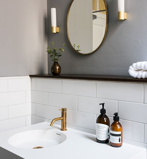 wall hung basin and bronze tap