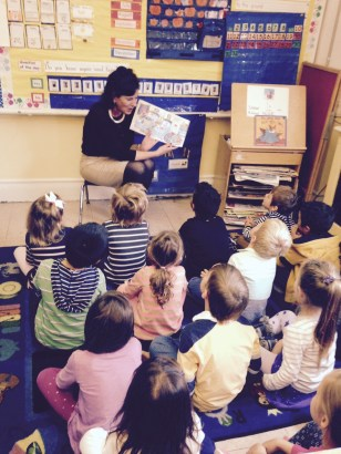 Lynn Smith, of M&T Bank, reads to a Kindergarten class at Elysian Charter School in Hoboken.