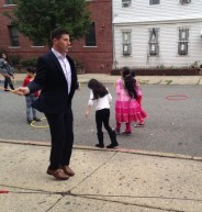 Tom McArdle, from IMC Financial, during 3rd grade recess at The Ethical Community Charter School, in Jersey City.