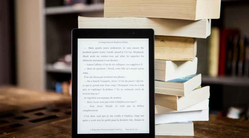 Marathi eBooks black tablet computer behind books