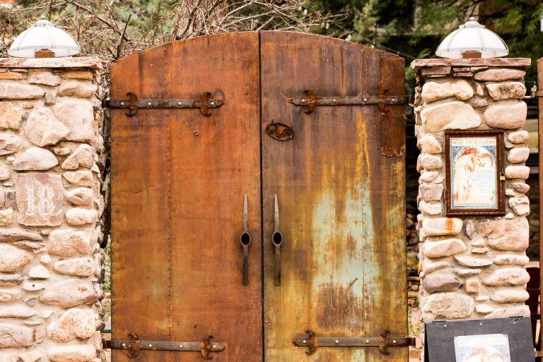 Brick pillars with metal double doors.