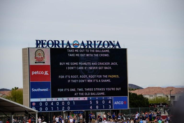 The lyrics to Take Me Out to the Ballgame on the scoreboard.