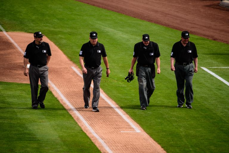 MBL umpires walking down the baseline to start the game.