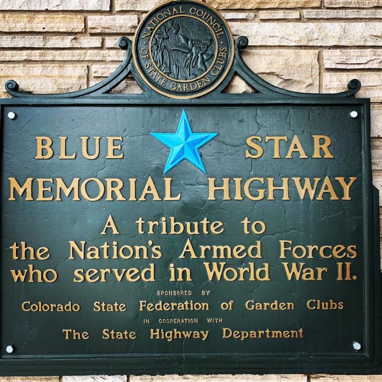 """Bronze plaque with wording """"Blue Star Memorial Highway"""""""