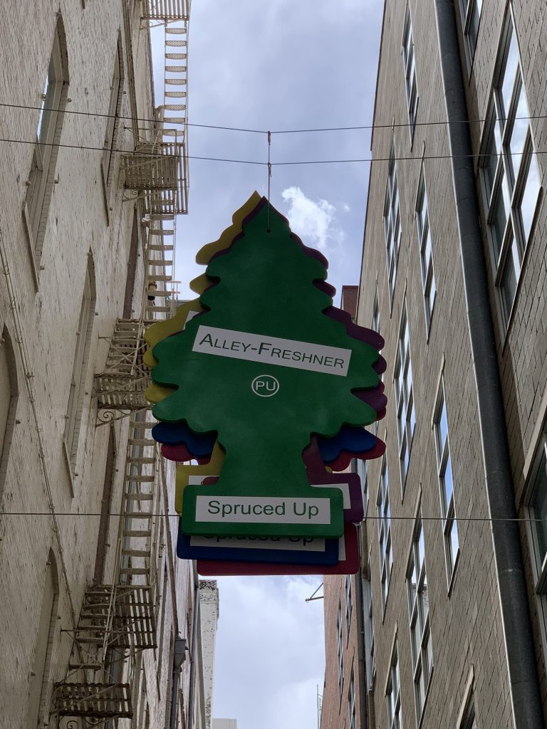 """""""Alley Freshner"""" in the alleyway across the street in the shape of a car freshener tree."""