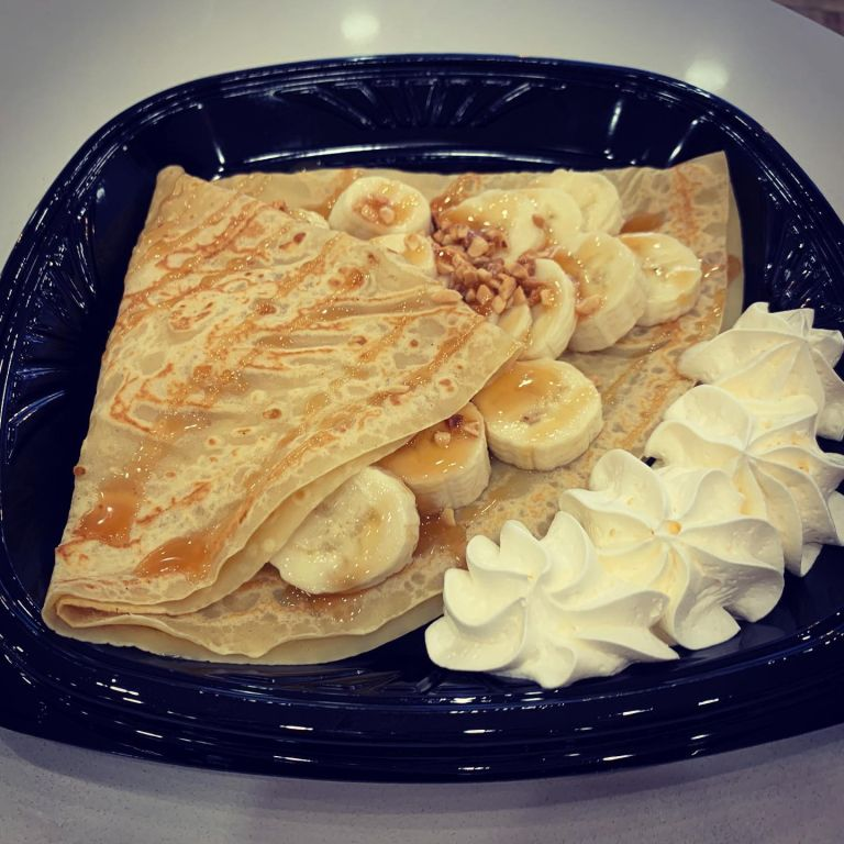 Banana nut crepe on the plate.
