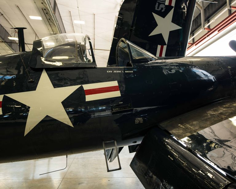 A Vought F4U Corsair plane, looking at the cockpit from the right side.