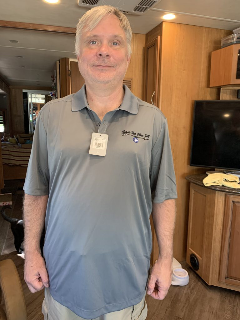 Bob modeling our new Chase the Blue Dot polo shirt.