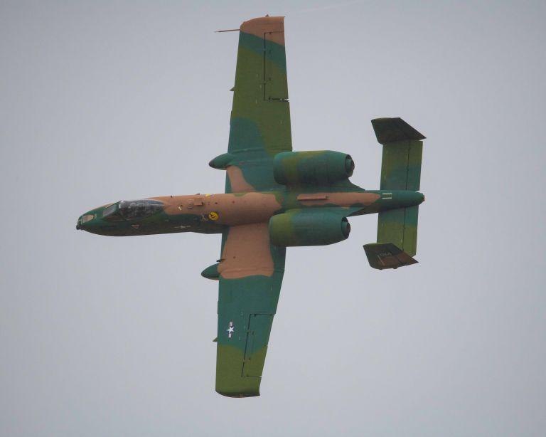 A plane flying sideways.