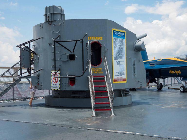 A 38 caliber naval gun mounted on the flight deck.