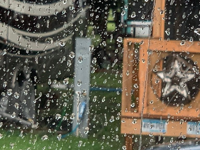 Rain coming down the windshield in the RV.