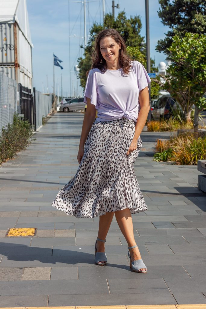 Pleated skirt with tied tee