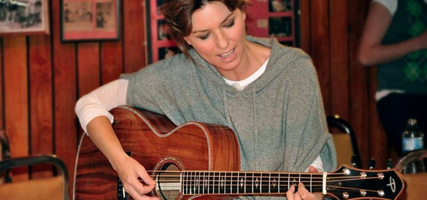 Shania Twain with her Prestige guitar