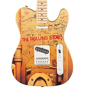 "Initially banned ""bathroom wall"" album cover art adorns the front of the guitar."