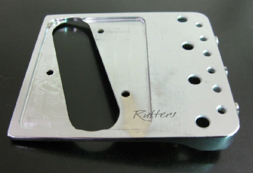 "The back is cut around pickup to retain ""Twang"""