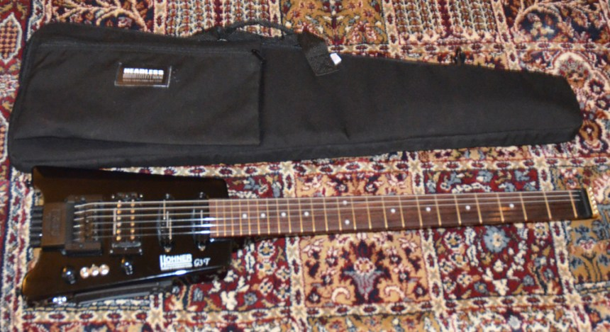 With padded gig bag from HeadlessUSA
