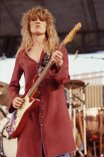 Nancy Wilson playing a red Strat