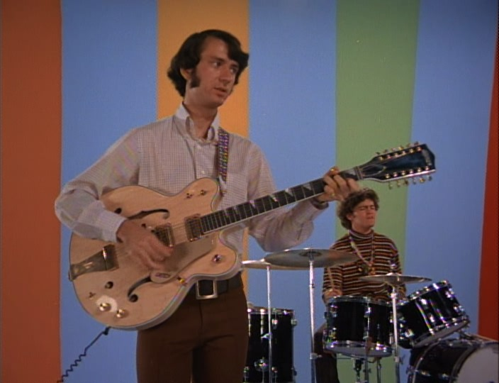 Mike Nesmith of the Monkees with his 12-string Gretsch guitar