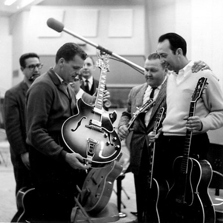 Tony Rizzi, Bobby Gibbons, Milt Norman, Bob Bains, Tiny Timbrell and Barney Kessell check out the Gibson Barney Kessel model - Feb 1961