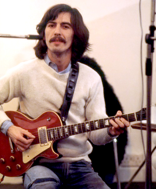 "George with ""Lucy"" Gibson Les Paul with was a gift from Eric Clapton"