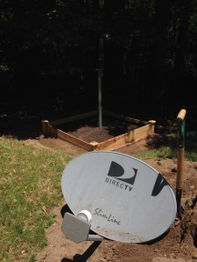 The dish and pole with a garden box.