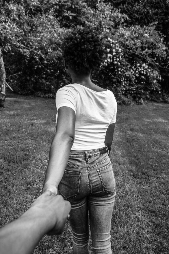 Woman-Leading-Partner-Holding-Hands