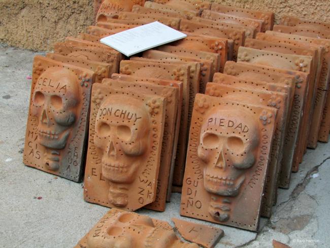Bas-relief clay plaques by Efren Gonzalez