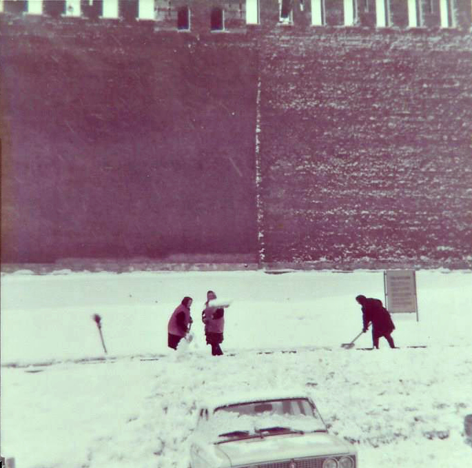 women shoveling snow in Red Square