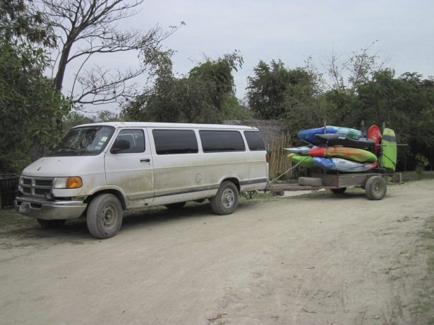 van loaded with boats