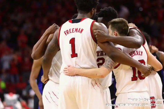 NC State players huddle before the free throw.<br><i>photo by Gene Galin</i>
