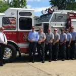 mike causey at the pittsboro fire and rescue department. Chatham County manager Renee Pascal joined in for the group picture.