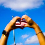 human hands and us flag