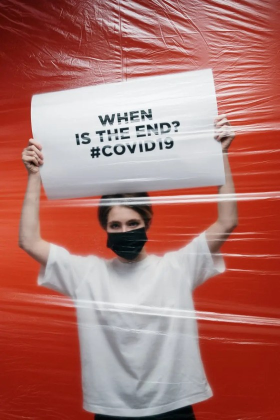 woman holding a poster with anxiety