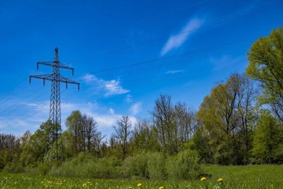 black utility post on grass field