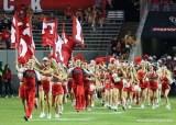 NC State cheerleaders running onto field