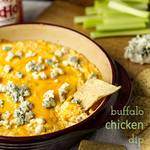 Quick Buffalo chicken dip is ready in less than thirty minutes and it's sure to be a hit with all the guests at your next party! | recipe from Chattavore.com