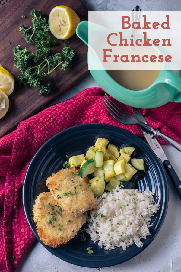 an overhead picture of baked chicken Francese on a plate with rice, zucchini, and yellow squash