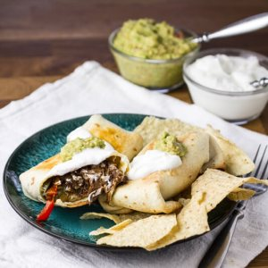 Baked chimichangas with shredded beef are an easy and delicious way to use up any leftover slow cooker pot roast you might have!   recipe from Chattavore.com