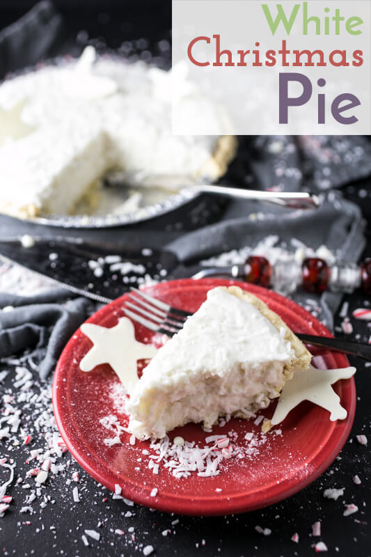 a photograph of a slice of Christmas pie with a whole pie in the background and coconut sprinkled on the background