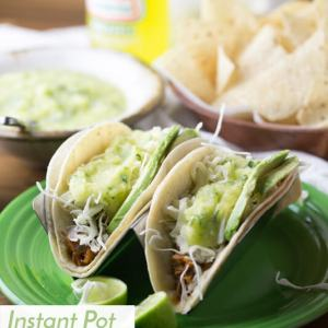 These Instant Pot pork tinga tacos are easy and so tasty! The Instant Pot does most of the work so you can get something else done while it cooks!   Recipe from Chattavore.com